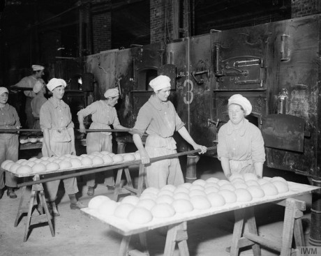 Members of the Women's Army Auxiliary Corps at work in a British Army bakery at Dieppe, France, on 10 February 1918. © IWM (Q 8475)