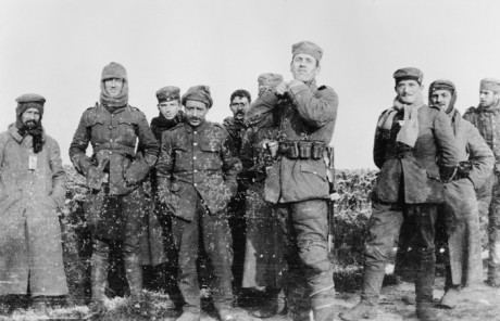 Second Lieutenant Cyril Drummond took this photograph of soldiers from the Royal Warwickshire Regiment talking happily with men from the 134th Saxon Regiment on Boxing Day.