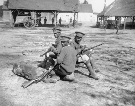 Q 1201: Troops of the West Indies Regiment cleaning their rifles on the Albert - Amiens road, September 1916.