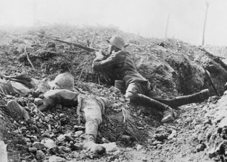 A German soldier takes aim, surrounded by French dead, at Verdun. Imperial War Museum/ Centenary Partnership Programme ref Q 23760.