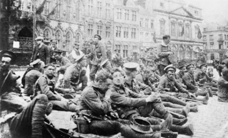 Men of the 4th Battalion, Royal Fusiliers rest in the Grand Place in Mons on 22 August 1914. Imperial War Museum/ Centenary Partnership Programme ref Q 70071.